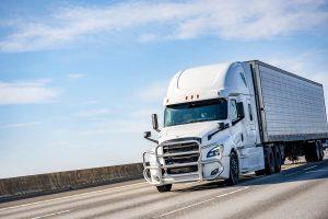 semi truck driving on a missouri highway