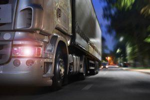 semi truck driving at night