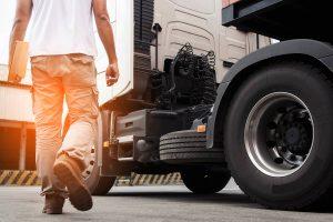 Missouri truck driver inspecting his semi-truck